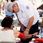 MVO Steve Glowinski FMCo takes the blood pressure of a PW resident